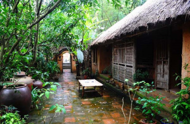 A rustic house surrounded by gardens and ponds immediately conveys a sense of the strong connection between Vietnamese people and their environment.