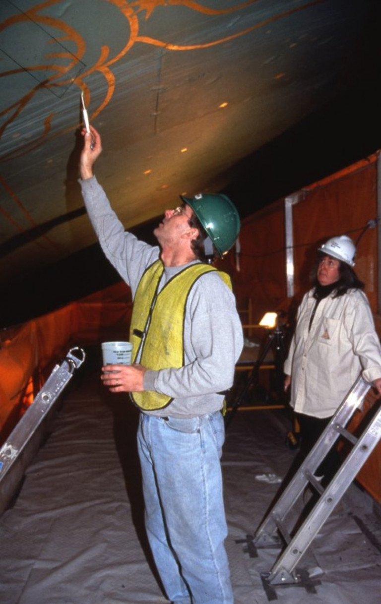 Restoration work is performed on the famous ceiling mural. Photo: Courtesy of the New York Transit Museum